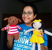 Anjana with her crocheted dolls