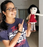 Anjana with a Crochet doll made by her for WOI