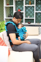 A Man carrying a baby
